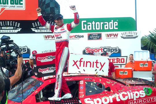 Denny Hamlin celebrates after winning the Sport Clips Haircuts VFW 200 at Darlington Raceway. He was later stripped of the win after his car failed inspection.