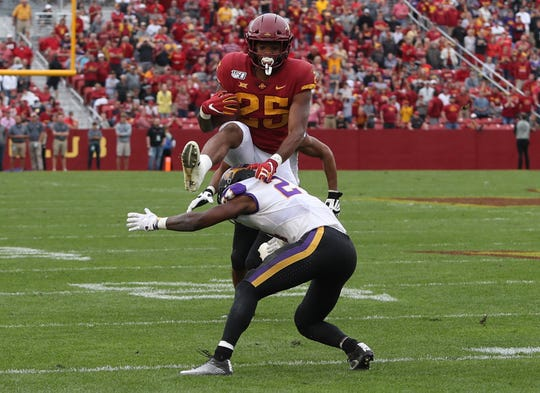Iowa State Cyclones running back Sheldon Croney Jr. (25) hurdles Northern Iowa Panthers defensive back Omar Brown at Jack Trice Stadium.