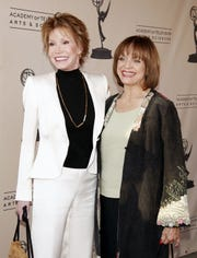 Mary Tyler Moore and Valerie Harper pose at the Academy of Television Arts and Sciences celebrating Betty White's 60 years on television on Aug. 7, 2008, in North Hollywood.