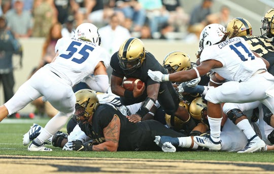 Army Black Knights quarterback Kelvin Hopkins Jr. dives for a first down against the Rice Owls during the first half at Michie Stadium.