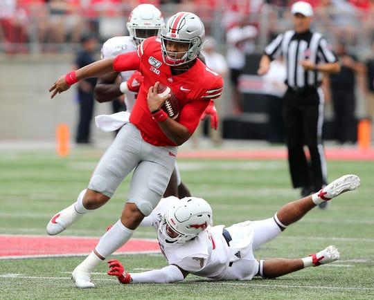Ohio State quarterback Justin Fields breaks free for a first quarter touchdown against Florida Atlantic at Ohio Stadium.