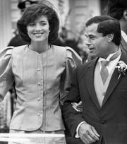 Maid of Honor Caroline Kennedy and Best Man Franco Columbu, leave St. Francis Xavier Church after the wedding of Caroline's cousin Maria Shriver to Arnold Schwarzenegger in Hyannis, Mass. on April 26, 1986.