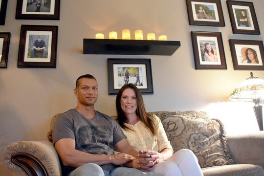 Ryan Ramnarace, left, and Tricia Harris sit together July 24, 2019, inside their West Baraboo, Wis. home. The couple shares a blended family including nine children and have navigated life together after Ramnarace was released from prison in 2015.