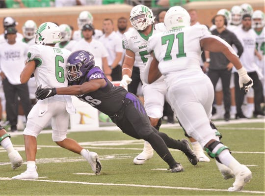ACU's Kameron Hill sacks North Texas quarterback Mason Fine late in the first quarter Saturday, Aug. 31, 2019, at Apogee Stadium in Denton.