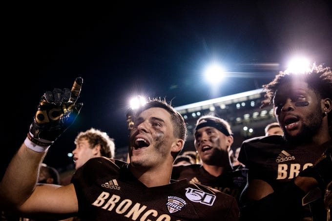 Western Michigan free safety Justin Tranquill (2) sings the Alma Mater after defeating Monmouth on Saturday, Aug. 31, 2019 at Waldo Stadium in Kalamazoo, Mich.