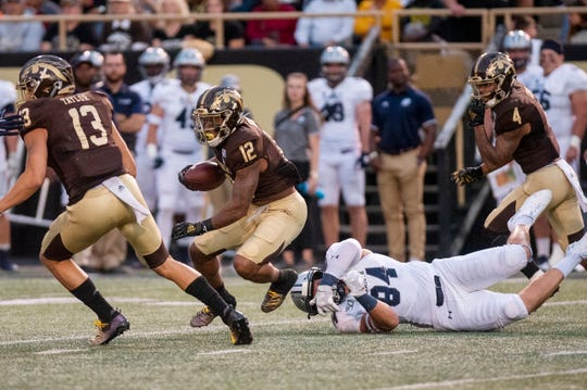 Monmouth tight end Gene Scott (84) fails to tackle Western Michigan wide receiver Keith Mixon Jr. on Saturday, Aug. 31, 2019 at Waldo Stadium in Kalamazoo, Mich.