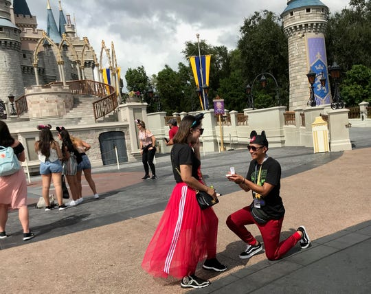 She said yes: A proposal, complete with mouse ears, in front of Cinderella Castle on Aug. 31, 2019. Whether they were there to relieve pre-Hurricane Dorian jitters or because they'd pre-planned vacations, crowds descended on Walt Disney World's Magic Kingdom and other parks over the Labor Day weekend.