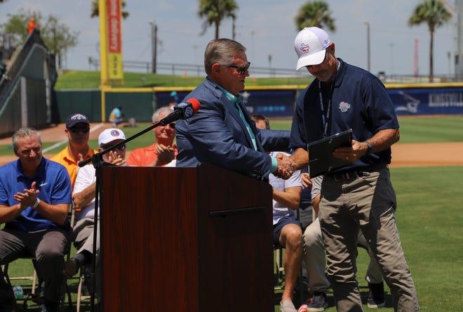 Corpus Christi mayor Joe McComb hands a proclamation to Hooks President Ken Schrom on Ken Schrom Day at Whataburger Field on Sunday, September 1, 2019 in Corpus Christi, Texas.