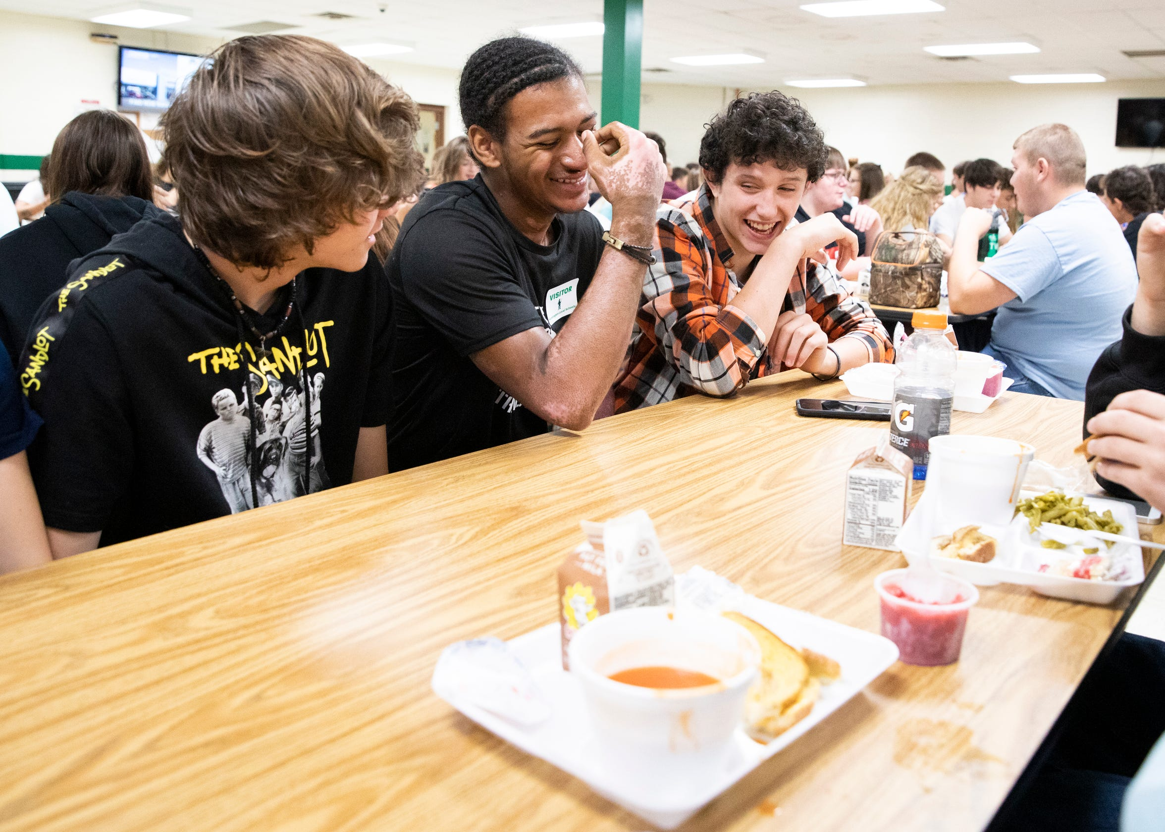 Canaan spends time at lunch with his friends during one of his last visits at Huntington High School. He would go back to Huntington School twice before he left for Ohio University to see his friends and to let them know he was doing okay.