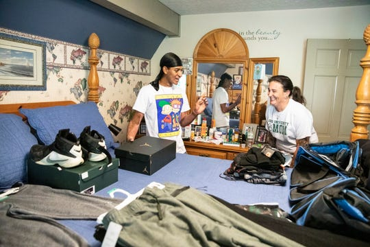 Canaan Knoles spends time with his mom as he packs up his clothes for college the day before he is scheduled to arrive at the Ohio University Campus on Wednesday, August 21, 2019.