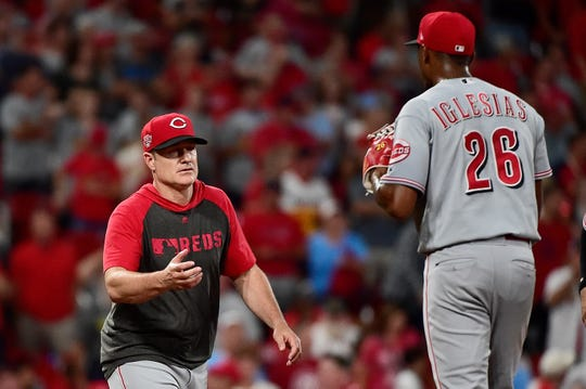 Aug 31, 2019; St. Louis, MO, USA; Cincinnati Reds relief pitcher Raisel Iglesias (26) is removed from the game by manager David Bell (25) during the ninth inning against the St. Louis Cardinals at Busch Stadium. Mandatory Credit: Jeff Curry-USA TODAY Sports