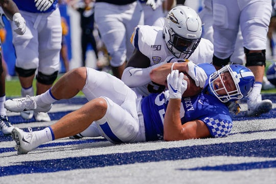 Kentucky tight end Justin Rigg (83) recovers a fumble for a touchdown during the first half of the NCAA college football game against Toledo, Saturday, Aug. 31, 2019, in Lexington, Ky.