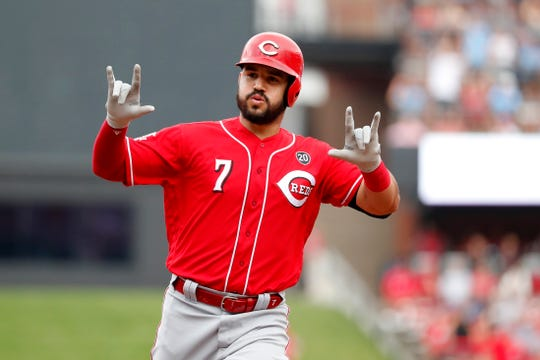 Cincinnati Reds' Eugenio Suarez celebrates as he rounds the bases after hitting a two-run home run during the third inning in the first baseball game of a doubleheader against the St. Louis Cardinals, Sunday, Sept. 1, 2019, in St. Louis.