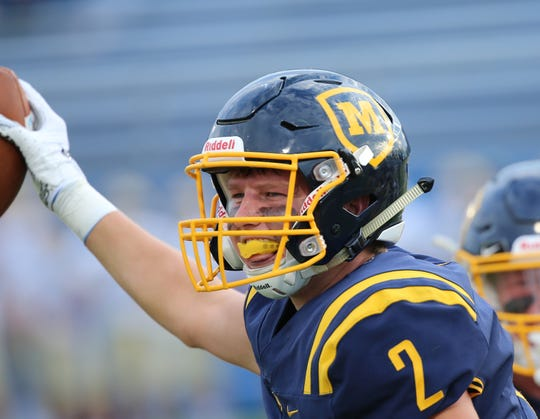Moeller's  Micheal Leonard  reacts after receiving a fumble during the Crusaders football game against Indy Cathedral, Saturday, Aug. 31, 2019.