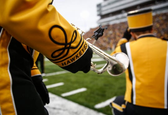 Members of the Iowa Marching Band take the field prior to kickoff against Miami of Ohio at Kinnick Stadium in Iowa City on Saturday, Aug. 31, 2019.
