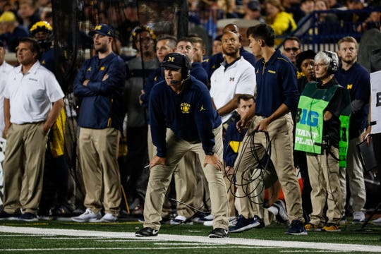 Jim Harbaugh watches a play during the first half Saturday.