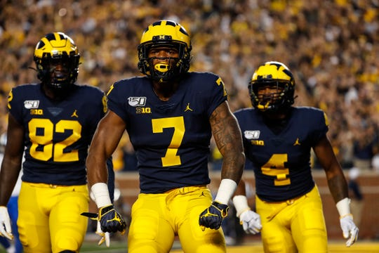 Michigan wide receiver Tarik Black (7) celebrates a touchdown against Middle Tennessee State during the first half at Michigan Stadium in Ann Arbor on Saturday, Aug. 31, 2019.