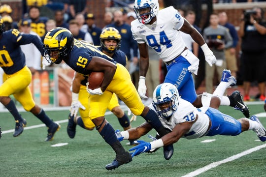 Michigan receiver Giles Jackson runs against Middle Tennessee State linebacker Chris Melton during the first half at Michigan Stadium, Saturday, August 31, 2019.