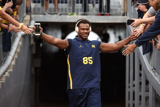 Michigan Wolverines tight end Mustapha Muhammad high-fives fans before the game against the Middle Tennessee Blue Raiders at Michigan Stadium, Aug. 31, 2019.