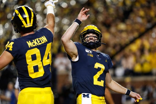 Michigan's Shea Patterson celebrates with Sean McKeon during the first half vs. Middle Tennessee State at Michigan Stadium, Saturday, August 31, 2019.