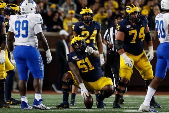 Michigan center Cesar Ruiz (51) talks to teammates during the second half against Middle Tennessee State at Michigan Stadium in Ann Arbor, Saturday, August 31, 2019.
