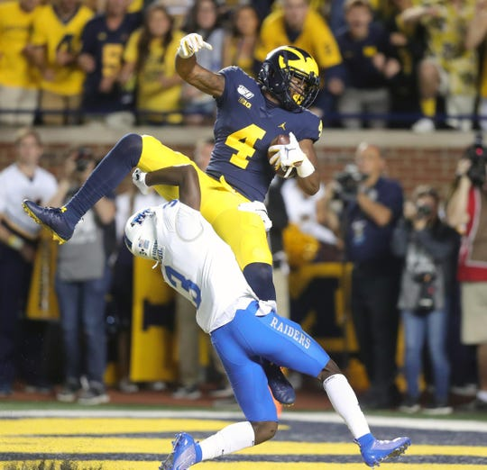 Michigan Wolverines receiver Nico Collins catches a touchdown against Middle Tennessee State Blue Raiders cornerback Gregory Grate Jr. during the first half Saturday, August 31, 2019 at Michigan Stadium.