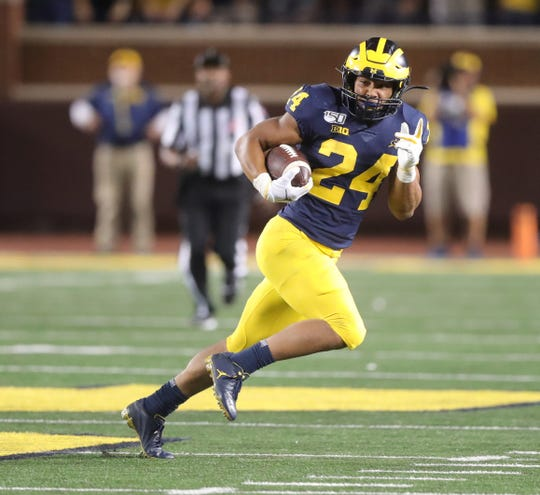 Michigan Wolverines' Zach Charbonnet runs against Middle Tennessee State during the first half Saturday, August 31, 2019 at Michigan Stadium.