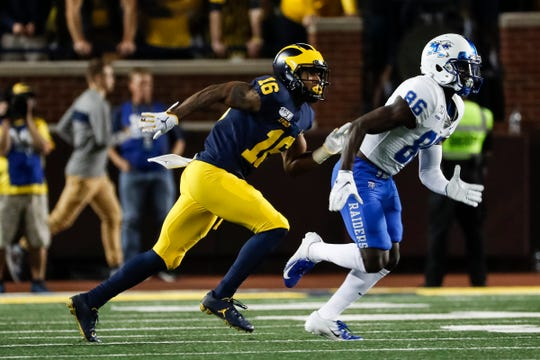 Michigan defensive back Jaylen Kelly-Powell defends Middle Tennessee State receiver Jarrin Pierce during the second half at Michigan Stadium in Ann Arbor, Saturday, August 31, 2019.