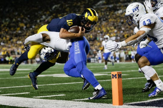Michigan quarterback Dylan McCaffrey is stopped on fourth-and-goal by Middle Tennessee State safety Jovante Moffatt during the second half at Michigan Stadium in Ann Arbor, Saturday, August 31, 2019.