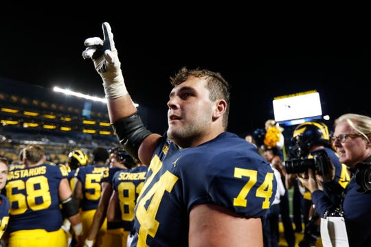 Michigan's Ben Bredeson celebrates the Wolverines' 40-21 win over Middle Tennessee State at Michigan Stadium in Ann Arbor, Saturday, August 31, 2019.