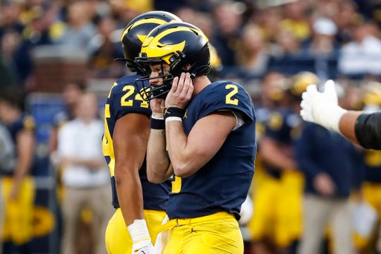 Michigan quarterback Shea Patterson reacts after fumbling during the first half against Middle Tennessee State at Michigan Stadium in Ann Arbor, Saturday, August 31, 2019.