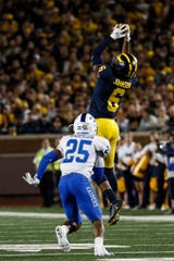 Michigan receiver Cornelius Johnson makes a catch over Middle Tennessee State cornerback Desmond Anderson during the first half at Michigan Stadium in Ann Arbor, Saturday, August 31, 2019.