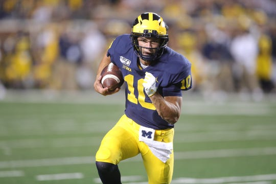 Michigan Wolverines quarterback Dylan McCaffrey runs against the Middle Tennessee State Blue Raiders, Saturday, August 31, 2019 at Michigan Stadium.