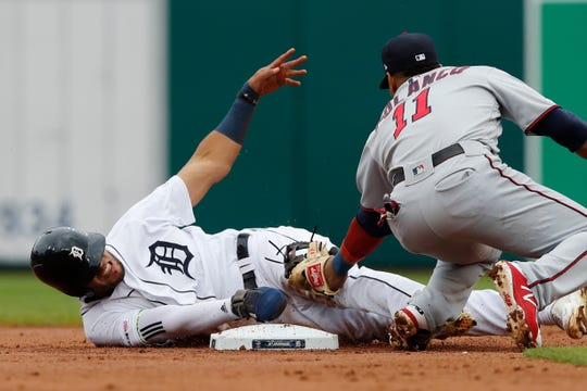 Tigers right fielder Victor Reyes, left, safely beats the tag of Twins shortstop Jorge Polanco at second base for a steal during the first inning on Sunday, Sept. 1, 2019, at Comerica Park.