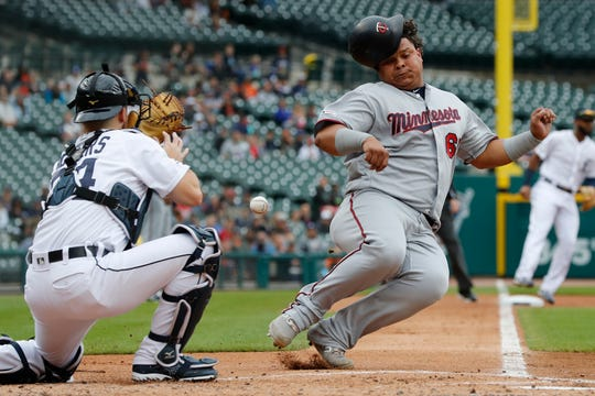 Twins first baseman Willians Astudillo, right, beats the throw to Tigers catcher Jake Rogers, left, to score from second on a single by teammate Jorge Polanco during the second inning on Sunday, Sept. 1, 2019, at Comerica Park.