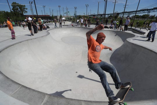 SKATEBOARD SUMMER - Mike Taylor works on his moves at the new skate park in Riverside Park in Detroit, Saturday, June 22, 2019.
