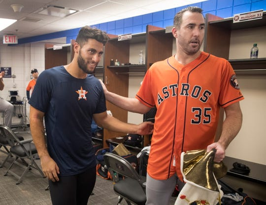 Astros pitcher Justin Verlander, right, celebrates in the clubhouse with teammate Abraham Toro after they defeated the Toronto Blue Jays in a baseball game in Toronto, Sunday Sept. 1, 2019. Verlander pitched a no-hitter and Toro hit a go-ahead two-run home run in the ninth.