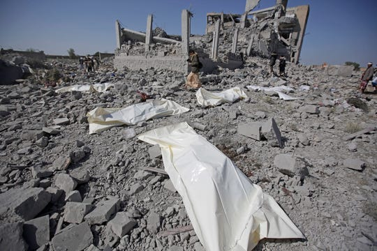 Bodies lie on the ground after being recovered from under the rubble of a Houthi detention center destroyed by Saudi-led airstrikes in Dhamar province, southwestern Yemen, Sunday.