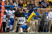 Michigan defensive back Ambry Thomas intercepts a pass intended for Middle Tennessee running back Brad Anderson in the second quarter on Saturday.