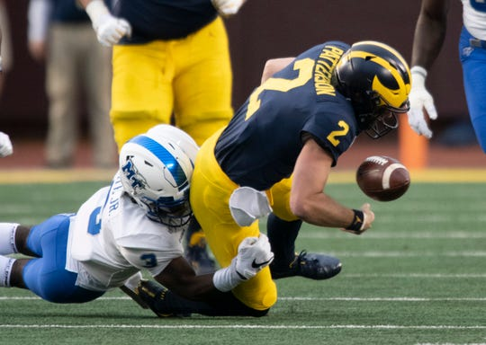 Michigan quarterback Shea Patterson fumbled on the first play from scrimmage in the season opener against Middle Tennessee State.