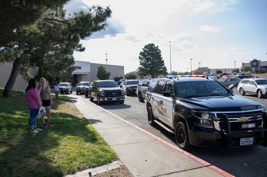 Odessa police officers park their vehicles outside Music City Mall in Odessa, Texas, Saturday, Aug. 31, 2019, as they investigate areas following a deadly shooting in the area of Odessa and Midland. Several people were dead after a gunman who hijacked a postal service vehicle in West Texas shot more than 20 people, authorities said Saturday. The gunman was killed and a few law enforcement officers were among the injured.
