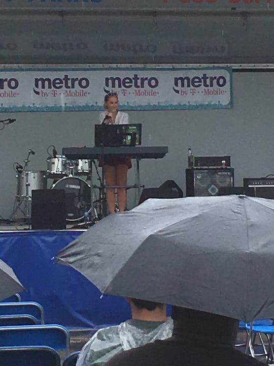 Canadian singer Julia Shuren shivered as she played to a sparse crowd in the rain Sunday morning at Arts, Beats & Eats in Royal Oak.