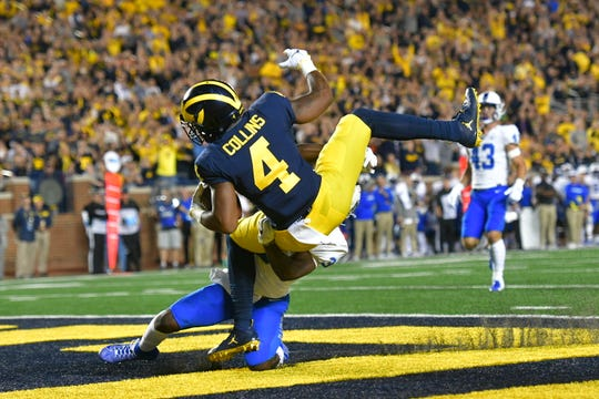 Michigan's Nico Collins hauls in a 28-yard touchdown reception in the second quarter.