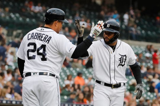 Detroit Tigers designated hitter Ronny Rodriguez, right, is greeted by Miguel Cabrera after they both scored on Rodriguez's two-run home run during the third inning.