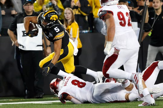 Iowa wide receiver Oliver Martin (5), who transferred from Michigan, tries to break a tackle by Miami of Ohio linebacker Luke Bolden (8) during the second half Saturday.