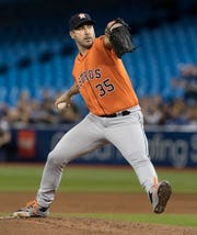 Houston Astros starting pitcher Justin Verlander throws against the Toronto Blue Jays during the first inning Sunday.