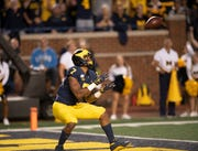 Michigan wide receiver Tarik Black hauls in a 36-yard touchdown pass from Shea Patterson in the season-opening victory over Middle Tennessee Aug. 31.