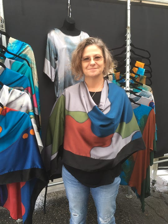 Virginia artist Tonya Butcher, who sells hand-painted silk clothing, says she's tired of hot weather -- and eager for customers to start thinking about the holidays.