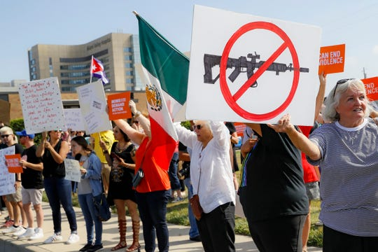 FILE - In this Aug. 7, 2019, file photo, demonstrators gather to protest after a mass shooting that occurred in Dayton, Ohio.