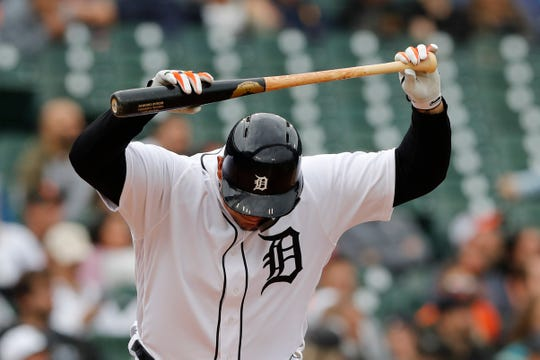 Detroit Tigers designated hitter Miguel Cabrera throws his bat after flying out to center field during the third inning.